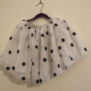 Girl's black and white polka dot skirt